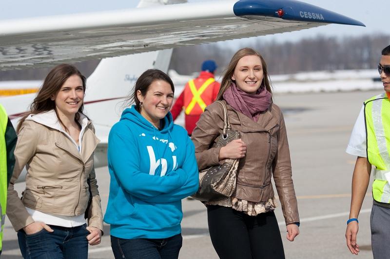 Girls takes flight during Women Of Aviation Week 2013